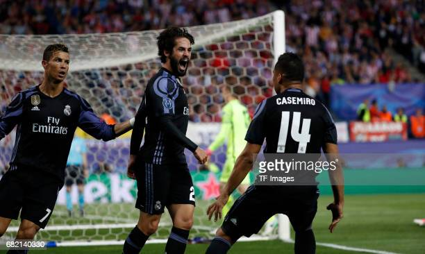 Isco of Real Madrid celebrates after scoring his team`s first goal with Cristiano Ronaldo of Real Madrid and Casemiro of Real Madrid during the UEFA...