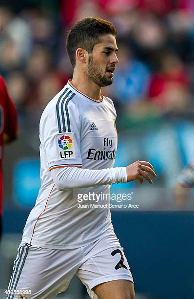 Isco of Real Madrid celebrates after scoring his third goal during the La Liga match between CA Osasuna and Real Madrid CF at Estadio Reyno de...