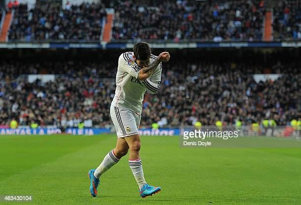 Isco of Real Madrid celebrates after scoring Real's opening goal during the La Liga match between Real Madrid CF and RC Deportivo La Coruna at...