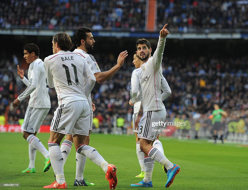 <a gi-track='captionPersonalityLinkClicked' href=/galleries/search?phrase=Isco&family=editorial&specificpeople=5848609 ng-click='$event.stopPropagation()'>Isco</a> of Real Madrid celebrates after scoring Real's opening goal during the La Liga match between Real Madrid CF and RC Deportivo La Coruna at Estadio Santiago Bernabeu on February 15, 2015 in Madrid, Spain.