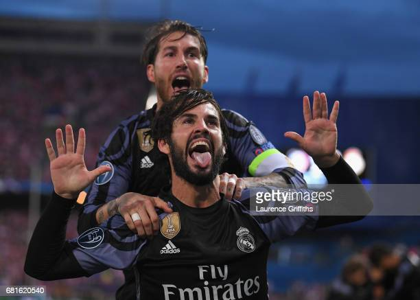 Isco of Real Madrid celebrates scoring his team's opening goal with Sergio Ramos during the UEFA Champions League Semi Final second leg match between...