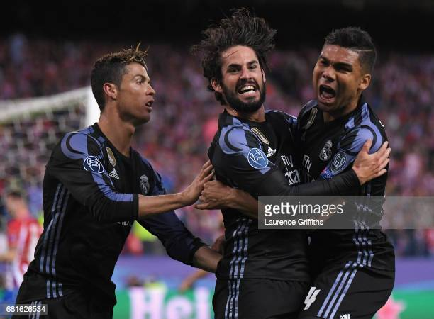 Isco of Real Madrid celebrates scoring his team's opening goal with Cristiano Ronaldo and Casemiro during the UEFA Champions League Semi Final second...
