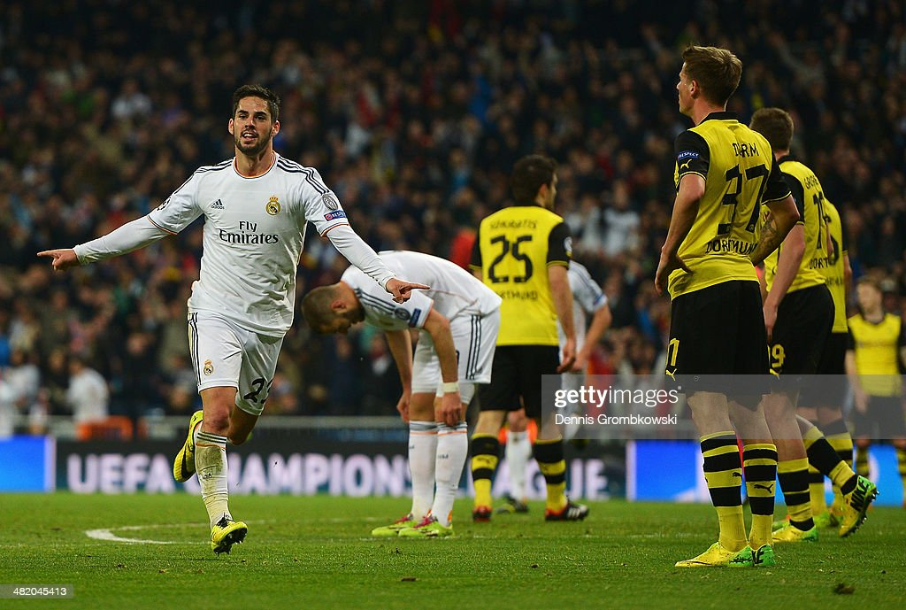 <a gi-track='captionPersonalityLinkClicked' href=/galleries/search?phrase=Isco&family=editorial&specificpeople=5848609 ng-click='$event.stopPropagation()'>Isco</a> of Real Madrid celebrates scoring his team's second goal during the UEFA Champions League Quarter Final first leg match between Real Madrid and Borussia Dortmund at Estadio Santiago Bernabeu on April 2, 2014 in Madrid, Spain.