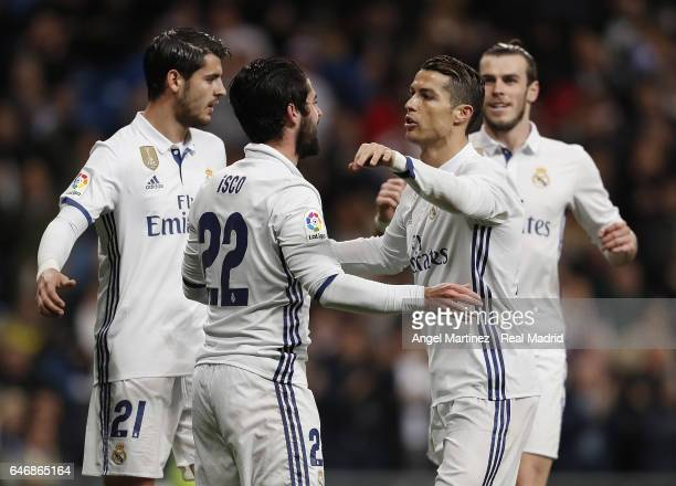Isco of Real Madrid celebrates with Cristiano Ronaldo Alvaro Morata and Gareth Bale after scoring the opening goal during the La Liga match between...