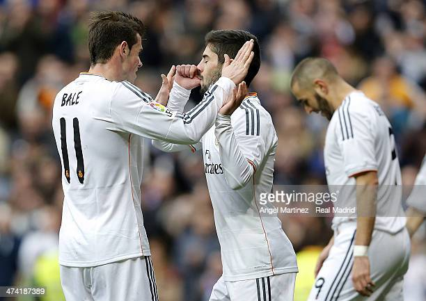 Isco of Real Madrid celebrates with Gareth Bale after scoring their team's third goal during the La Liga match between Real Madrid and Elche at...