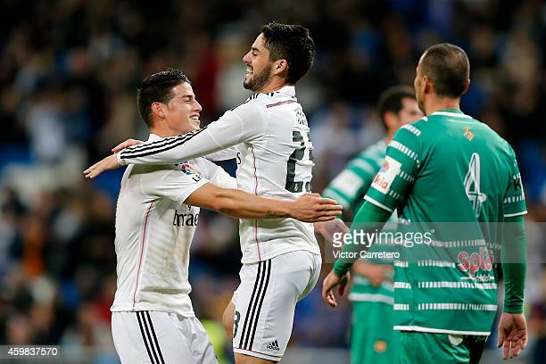 Isco of Real Madrid celebrates with his teammate James Rodriguez after scoring during the Copa del Rey round of 32 second leg match between Real...