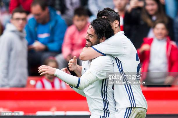 Isco of Real Madrid celebrates with his teammates Alvaro Morata of Real Madrid after scoring his team's third goal during the La Liga match between...