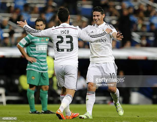 Isco of Real Madrid celebrates with James Rodriguez after scoring during the Copa del Rey round of 32 second leg match between Real Madrid and UD...