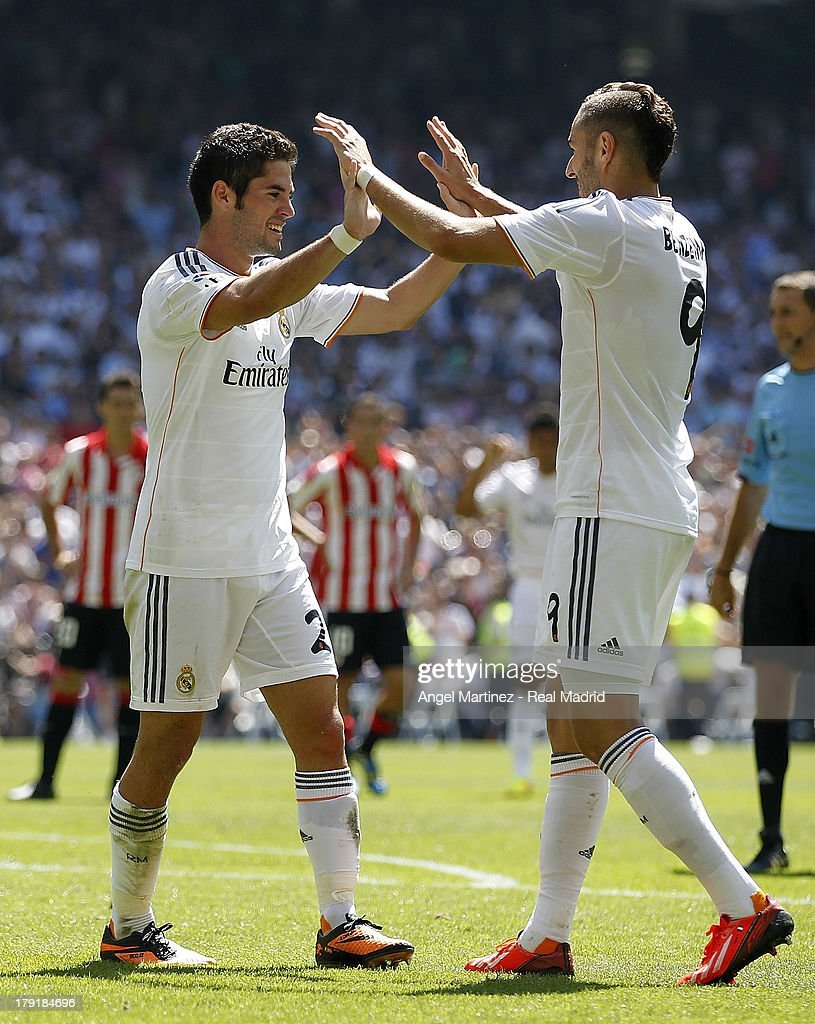 Isco (L) of Real Madrid celebrates with Karim Benzema after scoring their team's third goal during the La Liga match between Real Madrid and Athletic Club at Estadio Santiago Bernabeu on September 1, 2013 in Madrid, Spain.
