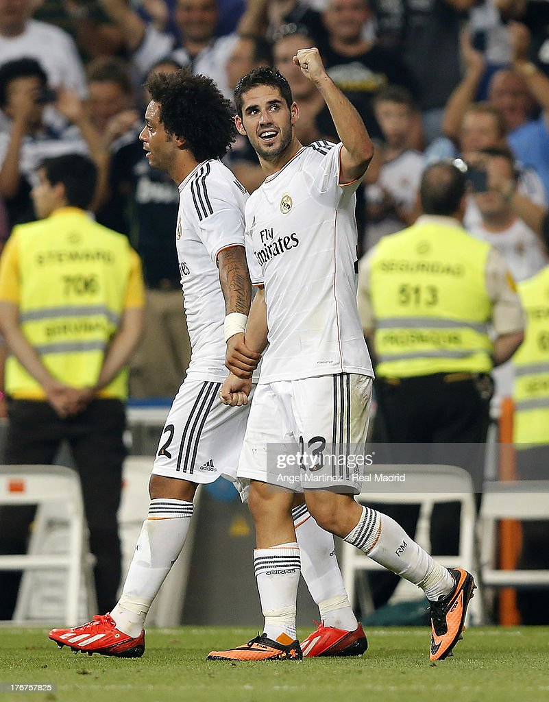<a gi-track='captionPersonalityLinkClicked' href=/galleries/search?phrase=Isco&family=editorial&specificpeople=5848609 ng-click='$event.stopPropagation()'>Isco</a> (R) of Real Madrid celebrates with <a gi-track='captionPersonalityLinkClicked' href=/galleries/search?phrase=Marcelo+-+Attacking+Left+Back+-+Born+1988&family=editorial&specificpeople=2136789 ng-click='$event.stopPropagation()'>Marcelo</a> Vieira after scoring their team's second goal during the La Liga match between Real Madrid CF and Real Betis at Estadio Santiago Bernabeu on August 18, 2013 in Madrid, Spain.