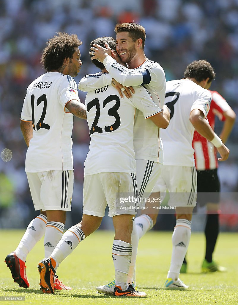Isco (C) of Real Madrid celebrates with Sergio Ramos (R) and Marcelo Vieira after scoring their team's third goal during the La Liga match between Real Madrid and Athletic Club at Estadio Santiago Bernabeu on September 1, 2013 in Madrid, Spain.