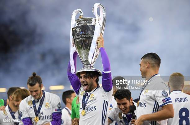 Isco of Real Madrid celebrates with The Champions League trophy after the UEFA Champions League Final between Juventus and Real Madrid at National...