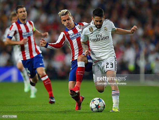 Isco of Real Madrid CF and Antoine Griezmann of Atletico Madrid battle for the ball during the UEFA Champions League quarterfinal second leg match...