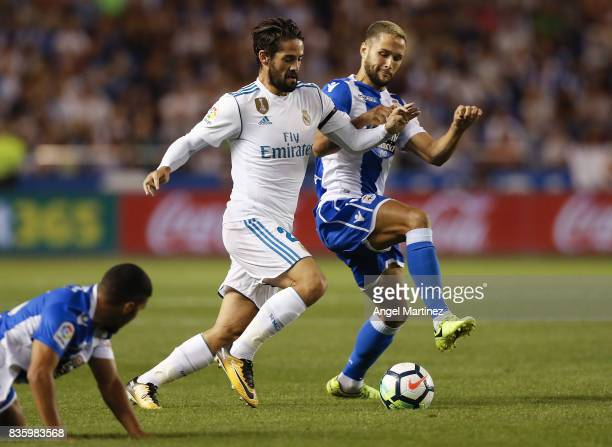 Isco of Real Madrid competes for the ball with Florin Andone of Deportivo La Coruna during the La Liga match between Deportivo La Coruna and Real...