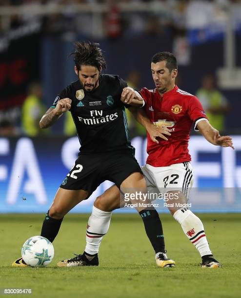Isco of Real Madrid competes for the ball with Henrikh Mkhitaryan of Manchester United during the UEFA Super Cup match between Real Madrid and...