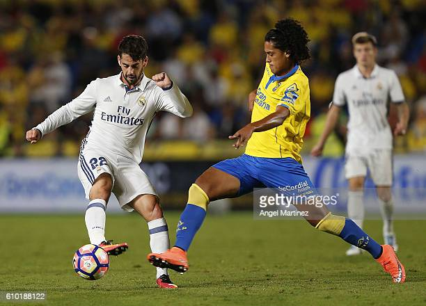 Isco of Real Madrid competes for the ball with Mauricio Lemos of UD Las Palmas during the La Liga match between UD Las Palmas and Real Madrid CF at...