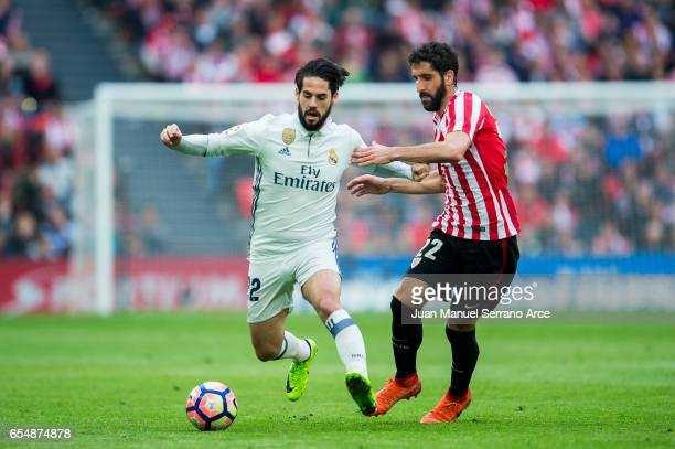 Isco of Real Madrid competes for the ball with Raul Garcia of Athletic Club during the La Liga match between Athletic Club Bilbao and Real Madrid at...