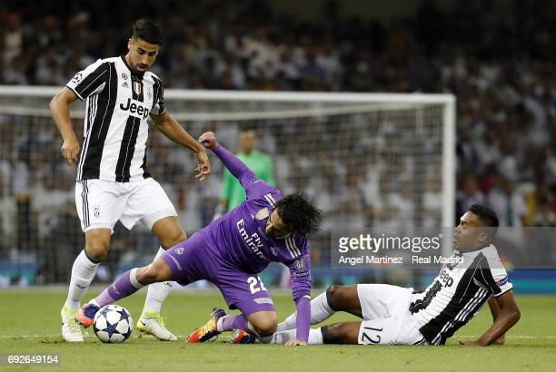 Isco of Real Madrid competes for the ball with Sami Khedira and Alex Sandro of Juventus during the UEFA Champions League Final match between Juventus...