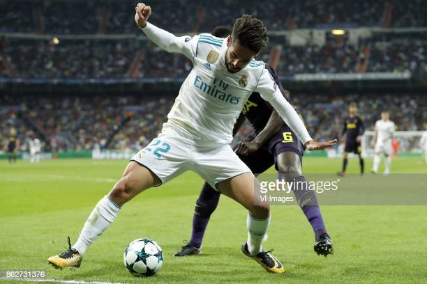 Isco of Real Madrid Davinson Sanchez of Tottenham Hotspur FC during the UEFA Champions League group H match between Real Madrid and Tottenham Hotspur...