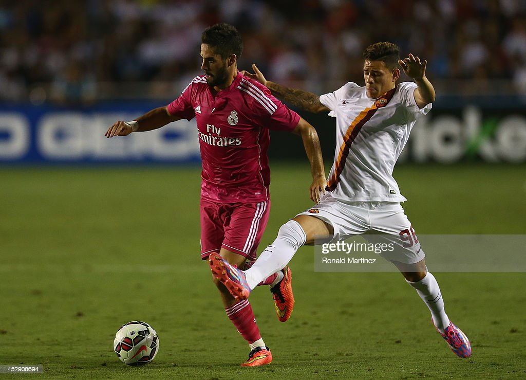 <a gi-track='captionPersonalityLinkClicked' href=/galleries/search?phrase=Isco&family=editorial&specificpeople=5848609 ng-click='$event.stopPropagation()'>Isco</a> #23 of Real Madrid dribbles the ball past <a gi-track='captionPersonalityLinkClicked' href=/galleries/search?phrase=Antonio+Sanabria&family=editorial&specificpeople=10788348 ng-click='$event.stopPropagation()'>Antonio Sanabria</a> #96 of AS Roma during a Guinness International Champions Cup 2014 game at Cotton Bowl on July 29, 2014 in Dallas, Texas.