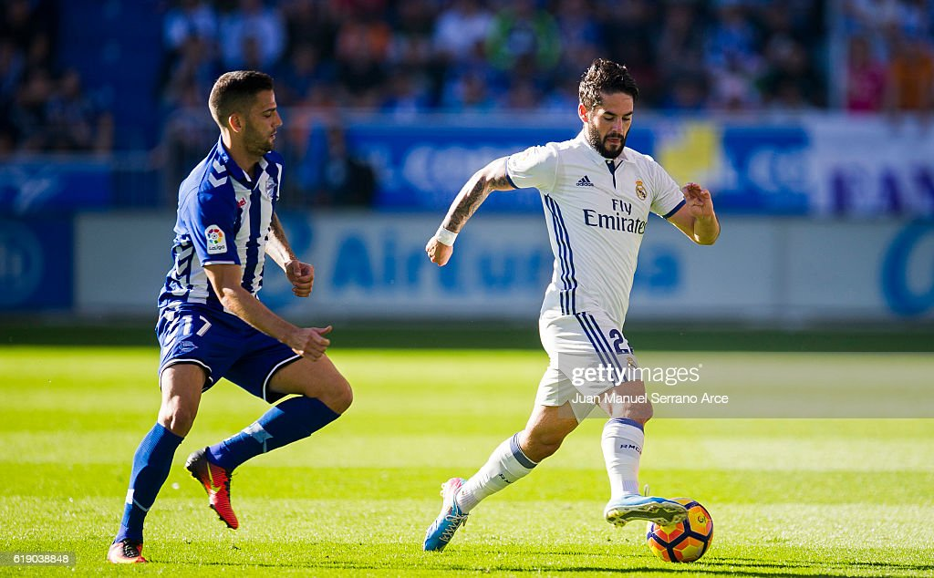 http://media.gettyimages.com/photos/isco-of-real-madrid-duels-for-the-ball-with-edgar-mendez-of-deportivo-picture-id619038848