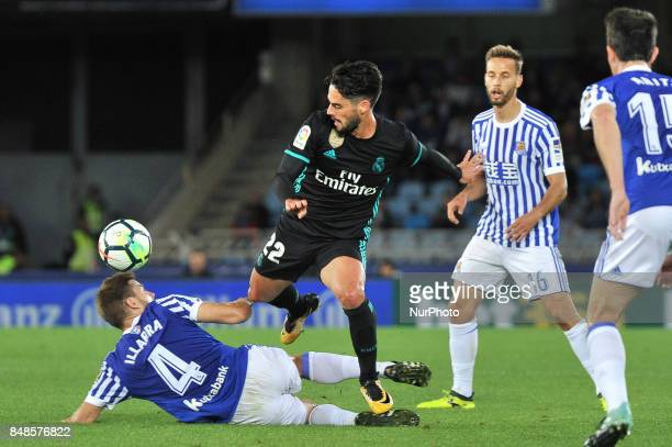 Isco of Real Madrid duels for the ball with Illarramendi of Real Sociedad during the Spanish league football match between Real Sociedad and Real...