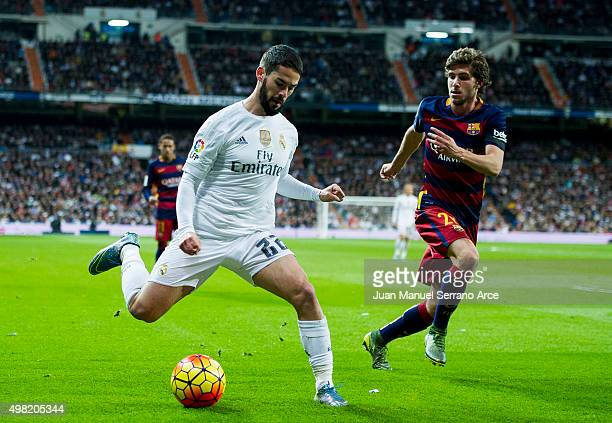 Isco of Real Madrid duels for the ball with Sergi Roberto of Barcelona during the La Liga match between Real Madrid CF and FC Barcelona at Estadio...