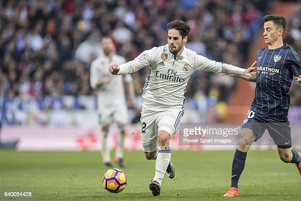 Isco of Real Madrid fights for the ball with Juan Pablo Anor Acosta Juanpi of Malaga CF during their La Liga 201617 match between Real Madrid and...