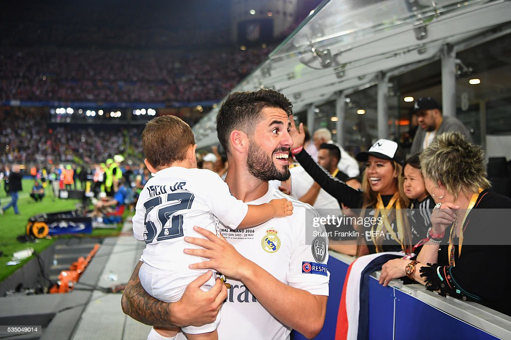 Isco of Real Madrid holding his child celebrates after the UEFA Champions League Final between Real Madrid and Club Atletico de Madrid at Stadio Giuseppe Meazza on May 28, 2016 in Milan, Italy..