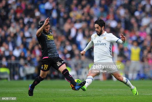 Isco of Real Madrid in action against Pablo Piatti of RCD Espanyol during the La Liga match between Real Madrid CF and RCD Espanyol at the Bernabeu...