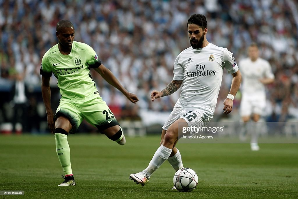 Isco (R) of Real Madrid in action Fernandinho of Manchester City during the UEFA Champions League semi-final second leg football match between Real Madrid and Manchester City at the Santiago Bernabeu Stadium in Madrid, Spain on May 4, 2016.