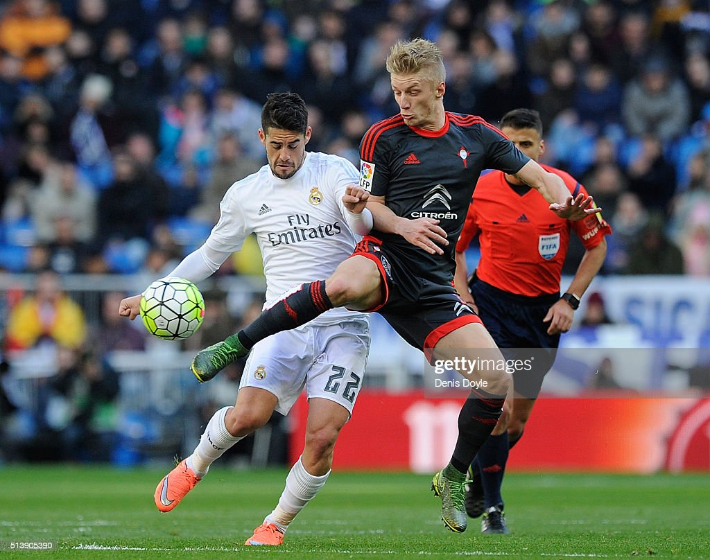 <a gi-track='captionPersonalityLinkClicked' href=/galleries/search?phrase=Isco&family=editorial&specificpeople=5848609 ng-click='$event.stopPropagation()'>Isco</a> of Real Madrid in action with <a gi-track='captionPersonalityLinkClicked' href=/galleries/search?phrase=Daniel+Wass&family=editorial&specificpeople=7487616 ng-click='$event.stopPropagation()'>Daniel Wass</a> of Celta Vigo during the La Liga match between Real Madrid CF and Celta Vigo at Estadio Santiago Bernabeu on March 5, 2016 in Madrid, Spain.