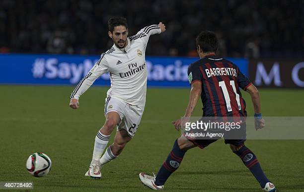 Isco of Real Madrid is action against Pablo Barrientos of San Lorenzo during the final football match with San Lorenzo within FIFA Club World Cup on...