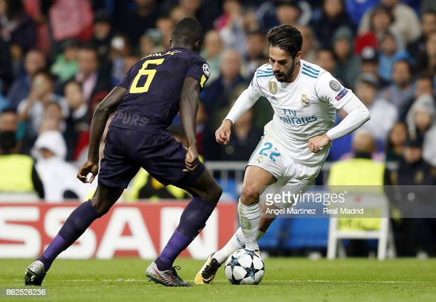 Isco of Real Madrid is challenged by Davinson Sanchez of Tottenham Hotspur during the UEFA Champions League group H match between Real Madrid CF and...