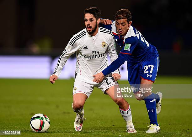 Isco of Real Madrid is challenged by Hernan Bernardello of Cruz Azul during the FIFA Club World Cup Semi Final match between Cruz Azul and Real...