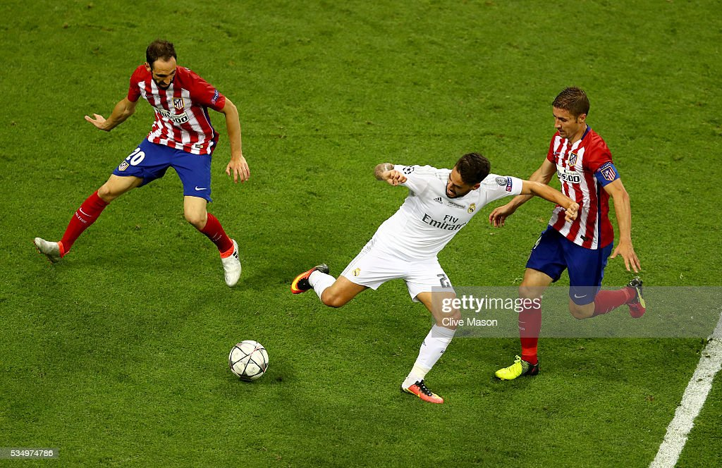 <a gi-track='captionPersonalityLinkClicked' href=/galleries/search?phrase=Isco&family=editorial&specificpeople=5848609 ng-click='$event.stopPropagation()'>Isco</a> of Real Madrid is challenged by <a gi-track='captionPersonalityLinkClicked' href=/galleries/search?phrase=Juanfran+-+Soccer+Right+Back+born+1985&family=editorial&specificpeople=2634439 ng-click='$event.stopPropagation()'>Juanfran</a> of Atletico Madrid and <a gi-track='captionPersonalityLinkClicked' href=/galleries/search?phrase=Gabi+-+Soccer+Player&family=editorial&specificpeople=6912055 ng-click='$event.stopPropagation()'>Gabi</a> of Atletico Madrid during the UEFA Champions League Final match between Real Madrid and Club Atletico de Madrid at Stadio Giuseppe Meazza on May 28, 2016 in Milan, Italy.