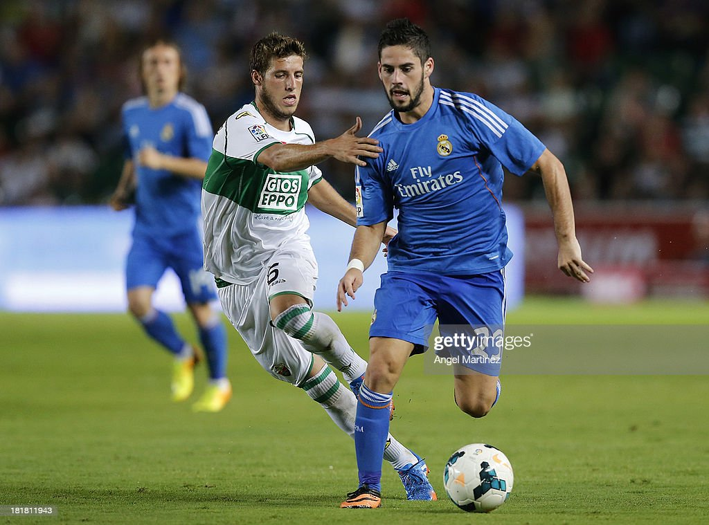<a gi-track='captionPersonalityLinkClicked' href=/galleries/search?phrase=Isco&family=editorial&specificpeople=5848609 ng-click='$event.stopPropagation()'>Isco</a> of Real Madrid is challenged by Ruben Perez of Elche FC during the La Liga match between Elche FC and Real Madrid at Estadio Manuel Martinez Valero on September 25, 2013 in Elche, Spain.