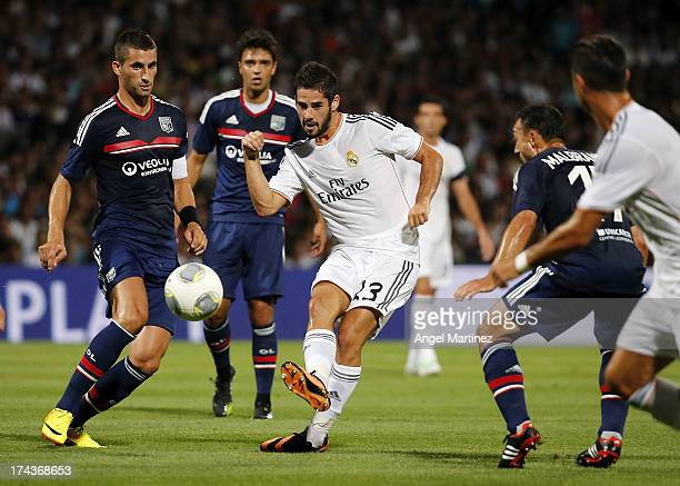 Isco of Real Madrid is chased by Maxime Gonalons and Steed Malbranque of Olympique Lyonnais during the preseason friendly match between Olympique...