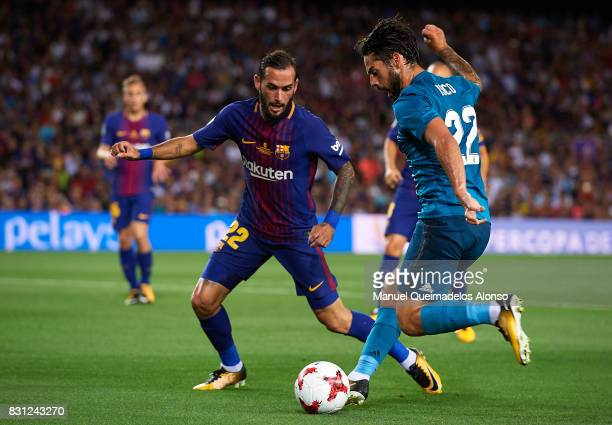 Isco of Real Madrid is closed down by Aleix Vidal of Barcelona during the Supercopa de Espana Supercopa Final 1st Leg match between FC Barcelona and...