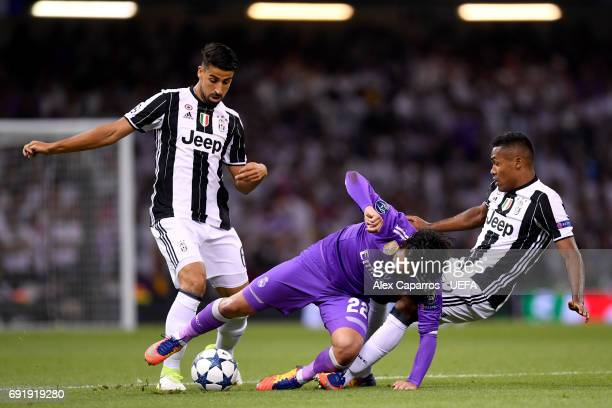 Isco of Real Madrid is fouled by Sami Khedira of Juventus and Alex Sandro of Juventus during the UEFA Champions League Final between Juventus and...