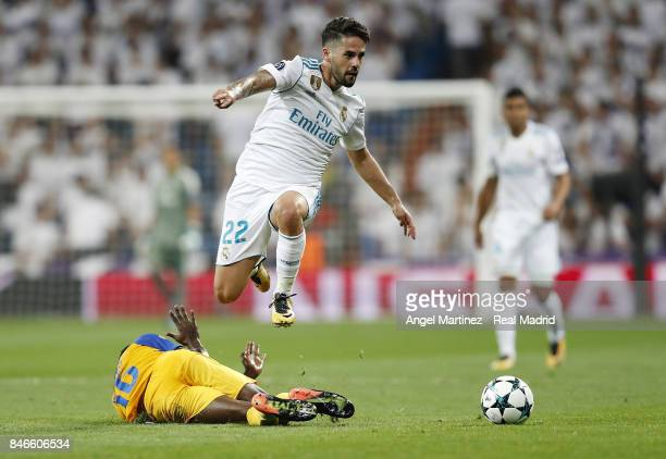 Isco of Real Madrid jumps over Vinicius of APOEL Nikosia during the UEFA Champions League group H match between Real Madrid CF and APOEL Nikosia at...