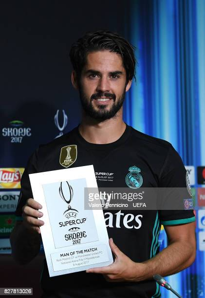 Isco of real Madrid receives the prize as the best player after the UEFA Super Cup between Real Madrid and Manchester United at Nacional Arena Philip...