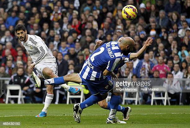 Isco of Real Madrid scores the opening goal past Manuel Pablo of Deportivo La Coruna during the La Liga match between Real Madrid CF and RC Deportivo...