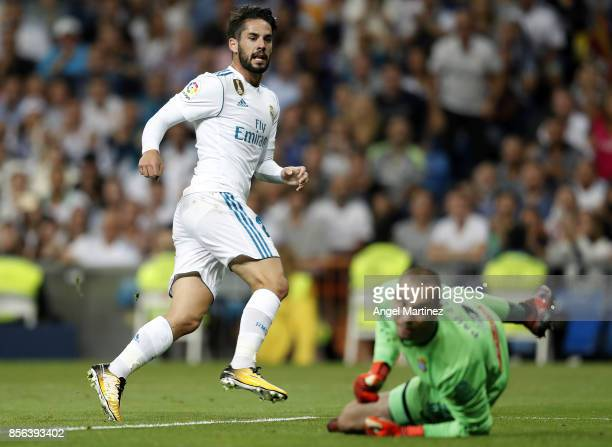 Isco of Real Madrid scores the opening goal past Pau Lopez of Espanyol during the La Liga match between Real Madrid and Espanyol at Estadio Santiago...