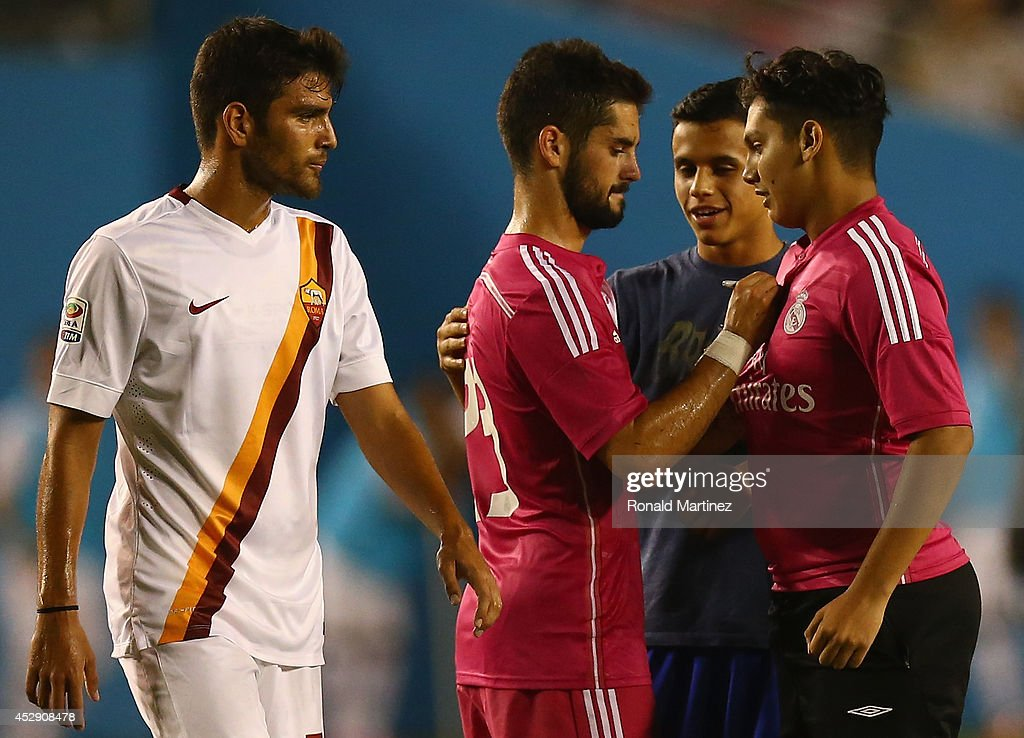 Isco #23 of Real Madrid signs an autograph for a fan, after fans disrupted the game against AS Roma during a Guinness International Champions Cup 2014 game at Cotton Bowl on July 29, 2014 in Dallas, Texas.