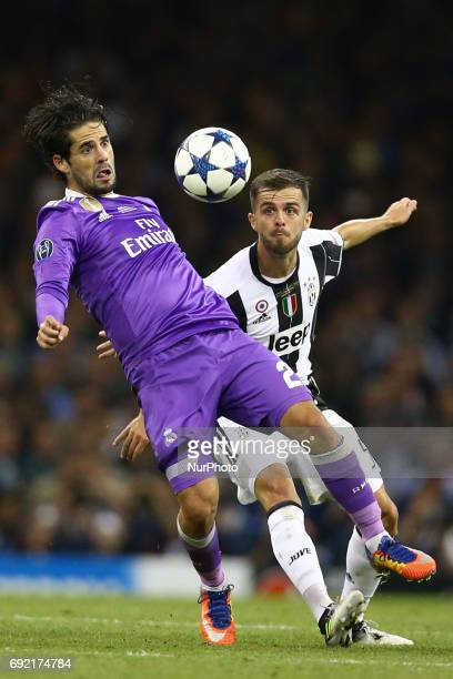 Isco of Real Madrid vies Miralem Pjanic of Juventus the UEFA Champions League Final between Juventus and Real Madrid at National Stadium of Wales on...