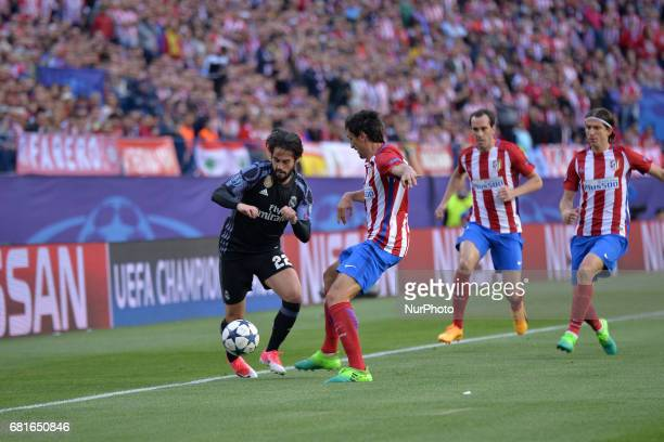 Isco of Real Madrid vies Savic of Atletico Madrid during the match between Real Madrid CF vs Atletico de Madrid as part of EUFA Champions League at...