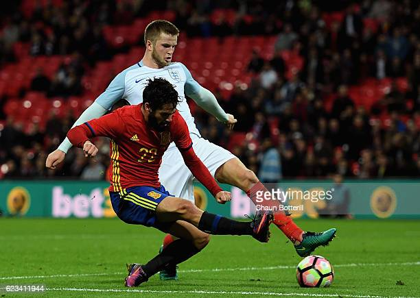 Isco of Spain beats Eric Dier of England to score their second and equalising goal during the international friendly match between England and Spain...