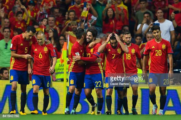Isco of Spain celebrates with his team mates after scoring his team's second goal during the FIFA 2018 World Cup Qualifier between Spain and Italy at...