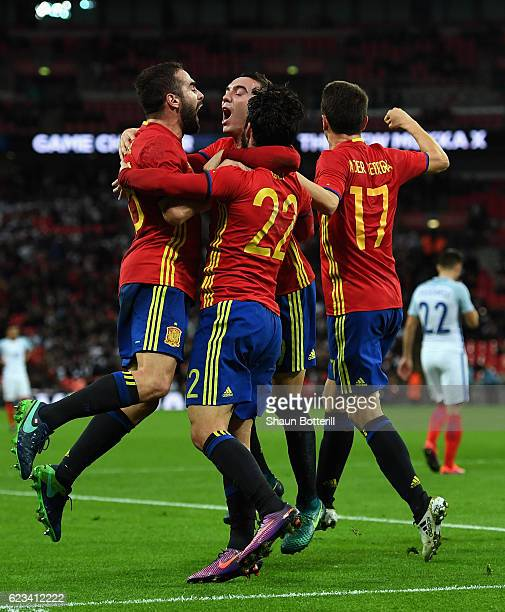 Isco of Spain celebrates with team mates as he scores their second and equalising goal during the international friendly match between England and...